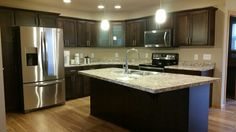 Beau New Kitchen With Stainless Steel Whirlpool Appliances, Dark Stained Custom  Cabinets By Auburn Ridge,