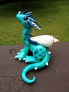 Sea Foam Dragon Sculpture  polymer clay by PatchRabbit on Etsy, $40.00 It's a water dragon like Solenne!