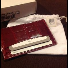 Judith Leiber Genuine Alligator Card Holder NEW!!! Judith Leiber Genuine Alligator Card Holder- brand new never been used! Original tag and box (I used to work for Judith Leiber) cranberry color. 2 card pockets on each side and middle slit total of 5 pockets. Made in South Africa. As seen in pictures has some blemishes as real alligator and skins will. Retailed at $195! MAKE AN OFFER!!! Judith Leiber Bags Clutches & Wristlets