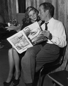 1946: Lauren Bacall and Humphrey Bogart reading 'Sea' magazine between acts at rehearsals for the CBS Lux Radio Theater