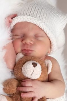 Precious! Would be super sentimental to have your baby holding one of your old teddy bears.: