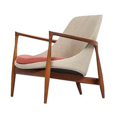 Ib Kofod-Larsen Elizabeth easy chair by Christensen & Larsen in Denmark | From a unique collection of antique and modern lounge chairs at https://www.1stdibs.com/furniture/seating/lounge-chairs/