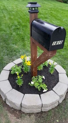 Classic Black Mailbox with Paving Stone Planter - Easy way to add style to your front yard! Classic Black Mailbox with Paving Stone Planter - Easy way to add style to your front yard! Mailbox Landscaping, Garden Landscaping, Mailbox Garden, Mailbox Planter, Planter Boxes, Budget Landscaping Ideas, Front Porch Garden, Front Porch Plants, Front House Landscaping
