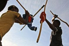 'Zulu Fighting Sticks' of South Africa, known as 'Izinduku'. Zulu fighting can be traced back to 1670, though it is also linked to Shaka Zulu (1787 -1828) Southern Africa's legendary warrior-king who was a highly proficient stick fighter by the age of 11. During Shaka's reign as king, Zulu stick fighting was used to train for self-defence and war, building courage and skill. #UWM #Zulu #fighting #weapons Fight Techniques, Stick Fight, Xhosa, Warrior King, African Culture, Zulu, Timeline Photos, Kickboxing, Muay Thai