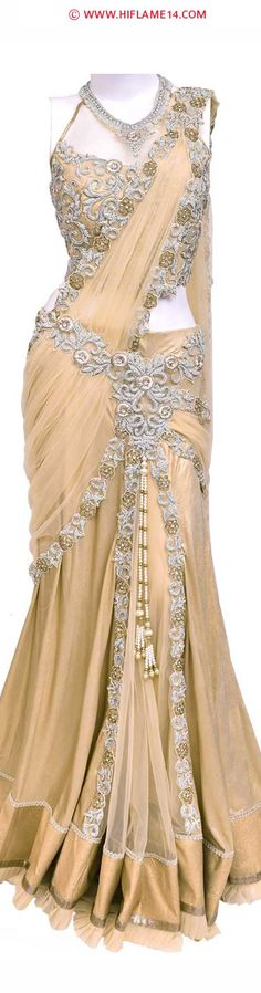 : Stunning Gold Lehenga Saree Give a grand look to your look by adorning this magnificent gold shimmer lehenga saree. The lehenga saree is beautifully decorated with amazing white stones and pearls and amazingly enhanced with ready pleated pallu. Saree Gown, Lehenga Saree, Bridal Lehenga, Saree Blouse, Satin Saree, Saree Wedding, Indian Dresses, Indian Outfits, Indian Clothes