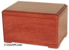 Urns Northwest  - Hamilton Cremation Urn, $139.00 (http://urnsnw.com/hamilton-cremation-urn/) Affordable solid cherry wood urn, made in the USA.