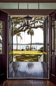 The view from the center hall and porch. #savannah #southernhomes #gardenandgun Photo Credit: Imke Lass.