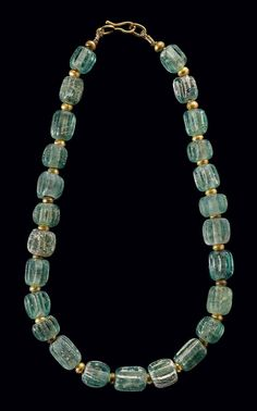A ROMAN GLASS BEAD NECKLACE -- Circa 200 BCE-100 CE