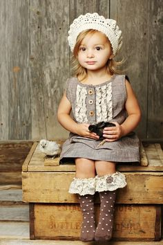 Gorgeous little girl and outfit, AND peeps! Love the lace on the socks. A must for my little girl...