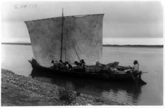 Arriving home - Noatak. Date Created/Published: c1929. Summary: Eskimo and dogs in sailboat. Photograph by Edward S. Curtis
