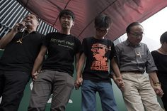Umbrella Revolution Hong Kong, (L-R) Benny Tai of prominent pro-democracy group Occupy Central and Hong Kong student leaders Alex Chow, Joshua Wong and Alan Leong, of the Civic Party attend a press conference at the pro-democracy protesters camp site in the Admiralty district of Hong Kong on October 26, 2014.