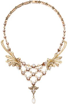 Gold, diamond and pearl necklace, circa 1900.  Featuring a natural pearl drop measuring approximately 7.9 by 7.0 mm, accented by 20 button-shaped pearls measuring approximately 4.5 to 4.1 mm, further set with numerous old mine, round and old European-cut diamonds weighing approximately 13.00 carats, the necklace gathered at the sides by flame motifs, length 15¼ inches, circa 1900. Via Diamonds in the Library.