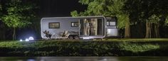 Ultraluxurious Glamper Astella blurs the line between Modular Home and Caravan Prefab Homes, Modular Homes, Luxury Caravans, Sofa Layout, Holiday Places, Floating House, Outside Living, Indoor Outdoor Living, Cool Apartments