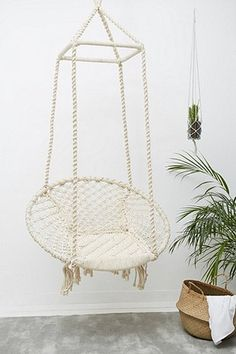 Marrakech Natural Swing Chair. I would love a hanging chair like this one in my living room. It looks like the perfect chair for relaxing in.