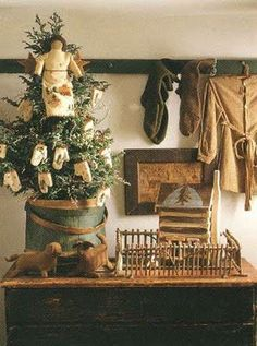 Love the tree in the firkin and the peg rack--so simple & pretty