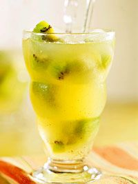Fizzy Kiwi Lemonade Recipe from Better Homes and Gardens. This drink is loaded with fresh fruit, much more nutritious than soda or bottled fruit drinks. Each serving meets the daily recommendation for vitamin C. The health benefits of Kiwis Fruit Drinks, Smoothie Drinks, Non Alcoholic Drinks, Healthy Drinks, Smoothies, Beverages, Vodka Cocktails, Party Drinks, Smoothie Recipes