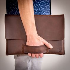 The Ultimate Gift Guide For The Modern Man (40+ Ideas!) | A leather laptop sleeve keeps the precious cargo safe and makes your man look extra stylish and professional.