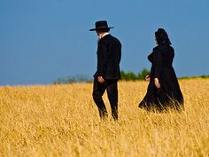 Love the contrast of the black clothes with the golden fields and bright blue sky.