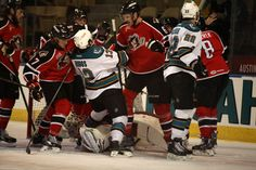 Worcester Sharks rookie forward Brock Higgs is caught in the midst of a scrum up inside the Portland Pirates goal crease (April 1, 2014).