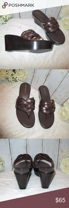 """NWOB Wedge Sandal BCBGeneration Size 7 Dark Brown Stylish wedge sandals by BCBGeneration, Size 7, Dark Brown, top weaving design has silver throughout the brown, new without box, some minor marks on bottom of one of the soles, 3"""" heel, 1.5"""" front platform. Bundle 3 or more items to save 15% off and pay once for shipping. BCBGeneration Shoes Sandals"""
