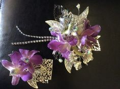 Absolutely stunning, glitzy prom corsage covered and silver jewels and leaves with lavender orchids. Matching magnetic boutonniere. By stems and vines floral studio.