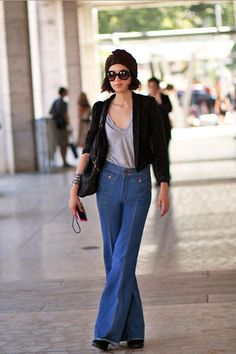 New York Fashion Week Street Style - Discover More Street Chic - Elle A showgoer wears vintage jeans and Prada sunglasses.