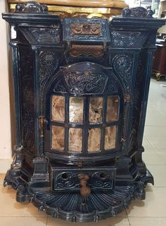 Antique Kitchen Stoves, Antique Wood Stove, How To Antique Wood, Vintage Wood, Wood Burning Furnace, Wood Burning Heaters, Outdoor Wood Furnace, Black Dog Salvage, Coal Stove