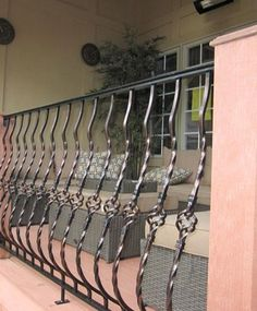 Wrought Iron Balcony on Custom Outdoor Stair Design