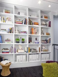 White bookshelves, black floorboards