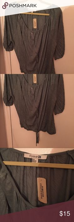 NWT Forever 21 Green Gray Knit Top Size Large NWT! 100% Rayon beautiful top on a soft heather teal color. Faux button and tie on bottom. Very flattering and forgiving. Forever 21 Tops Blouses