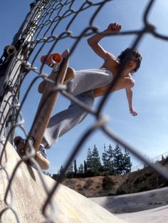 Love the angle through the fence - skateboarding