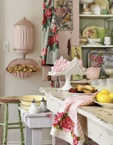Pink and green kitchen. I like the pink lavabo on the wall. I never knew what to do with a milk glass banana bowl/stand. Putting napkins in it is a good idea