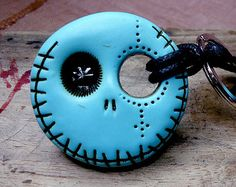 Sky blue round skull with a hollow eye. Brooch, keychain, pendant or magnet (you choose)