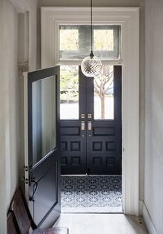 A BROWNSTONE IN CLINTON HILL - door color, hanging light.