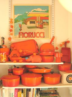 Orange Le Creuset 'Flame' cast iron collection + vintage poster in Wary Meyers' kitchen Home Design, Interior Design, Portland, Le Creuset Cookware, Orange Kitchen, Kitchen Colors, Kitchen Stuff, Kitchen Gadgets, Orange Interior