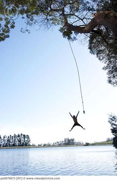 swing from a rope into a lake