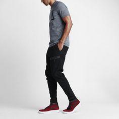 Nike bonded woven zip pocket pants.