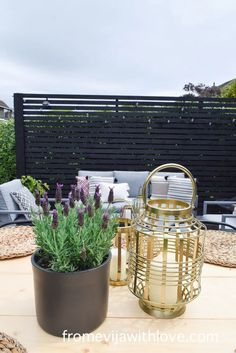 Garden Patio Area makeover, custom built black wooden privacy screen, grey slabbed area. Garden Slabs, Gold Lanterns, Fence Lighting, Large Planters, Amazing Spaces, Diy Patio, Modern Spaces, Outdoor Cushions, Decking