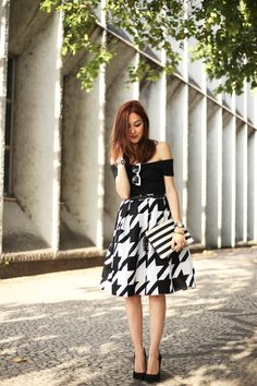 Black and white outfit wearing a gorgeous pied de poule (pied de coq!) skirt and a black top with amazing high heels and bicolour sunglasses.