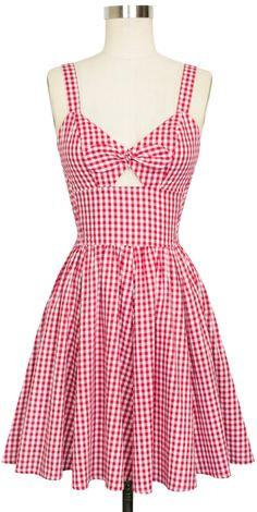 Inspired by the classic vintage styles of the South, Trashy Diva's Red Gingham Collection is here in new original designs and signature favorites. The name says it all! Trashy Diva's super retro Hottie Mini Dress has returned in red gingham. This version of the Hottie Mini Dress features a front center tie that is stitched together with a closed front. The bodice details elastic ruching at the sides for fitted and comfortable wear. The adjustable shoulder straps feature three button holes…
