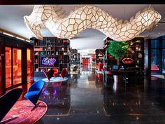 citizenM Shanghai Hongqiao, China by concrete Colorful styling and art evoke the space Citizen M, Area Comercial, Shanghai Hotels, Tree Bench, Vitra Design, Best Boutique Hotels, Patio Interior, Travel Dating, Hotel Guest