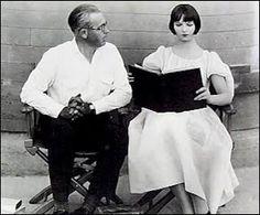 Louise Brooks reading on set.