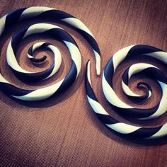 Spirals with a twist of color. plugs gauges tapers tribal http://www.etsy.com/shop/WanderlustPlugs?ref=shop_sugg