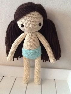 My first dolly from the book my crochet doll by Isabelle kessedjian, she just needs some more clothes now !