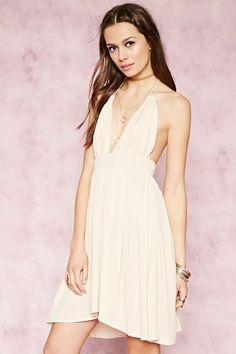 Forever 21 Contemporary - A crinkled woven crepe dress featuring tasseled self-tie halter straps, a smocked waist, and a plunging V-neckline with scalloped trim.