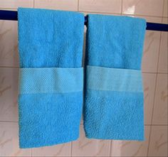 ucandostuff.com - How to fold bathroom hand towels with pockets to hang decoratively on a towel rack