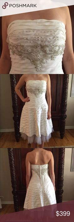 "NWOT Fiesta White/Crystal Tulle Dress. Size M Beautiful white and crystal encrusted dress. Size medium. Tulle layer on bottom. 100% polyester with beautiful pleated design. Tea length. Would work great as a wedding dress for someone or as a great party dress.  Fabulous detail. Back zipper. Model is 5'10"" with 34DD bust. fiesta Dresses Strapless"