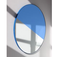 Delightful hand crafted mixed tinted (silver & blue gold) round mirror with a chic blue frame.  Ideal above a console table in the hallway, above a beautiful fireplace, in the bedroom or in the bathroom.  Available with exquisite solid brass or different colours frames. Choose the orientation of the mirror at installation that best suits you. Fitted with hardware so you may change it whenever you want.  Design tip: looks stunning used as a cluster in different sizes and/or colours.