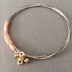 Handmade electric guitar string bracelet Handmade electric guitar string bracelet. Made from five used electric guitar strings and copper wire. Made by me ☺️ Jewelry Bracelets