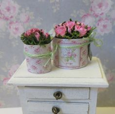 A single Dollhouse miniature pot  filled with flowers in scale 1:12